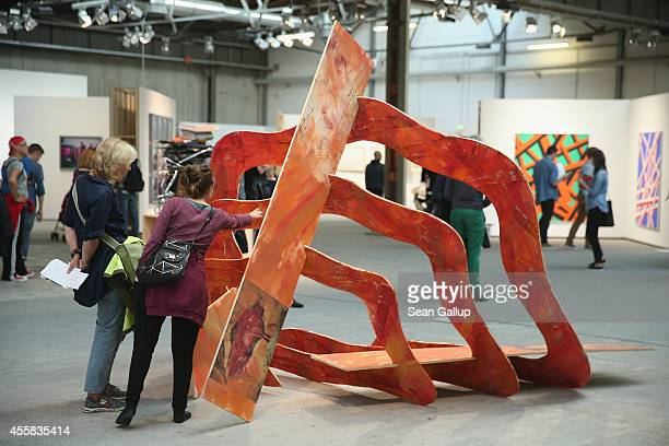 """Visitors look at a work by Zvi Hecker at the """"art berlin contemporary"""" art trade fair at The Station on September 20, 2014 in Berlin, Germany. The..."""