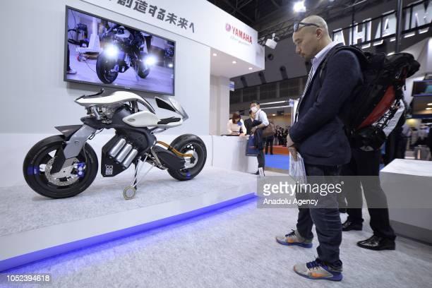Visitors look at a Yamaha Motor Co Motoroid T03 concept motorcycle with autonomous capabilities and balances at the Japan Robot Week 2018 at Tokyo...