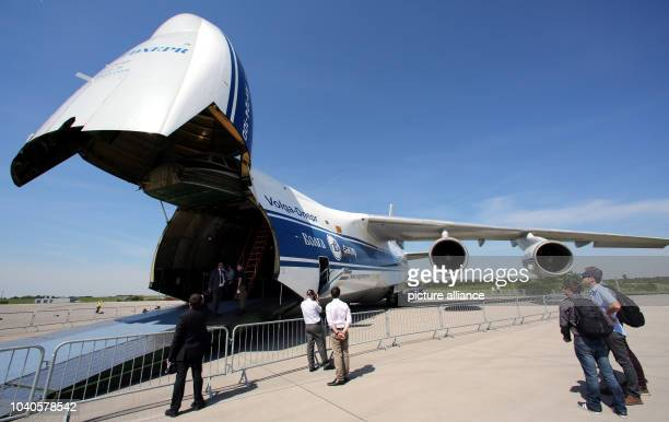 Visitors look at an Antonov AN 124100 aircraft at the ILA Berlin Air Show 2014 in Selchow Germany 21 May 2014 The aerospace and defence industry...