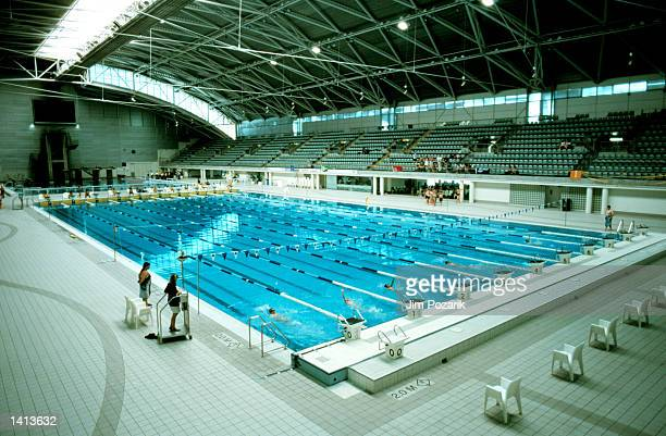 Visitors look at an Aquatic Center built for the Sydney 2000 Olympics in Sydney, Australia, March 30, 2000 .