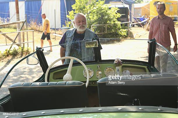 Visitors look at an East German1954 IFA F9 automobile at a Trabant enthusiasts' weekend on August 8 2015 near Nossen Germany The Trabant also called...