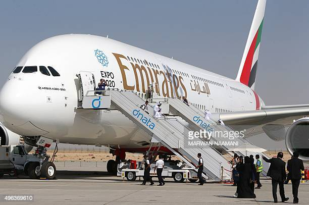 Visitors look at an Emirates airline's Airbus A380 dislayed at the Dubai Airshow on November 9 2015 AFP PHOTO / MARWAN NAAMANI