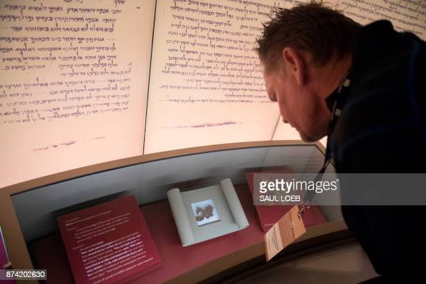 Visitors look at an exhibit about the Dead Sea scrolls during a media preview of the new Museum of the Bible a museum dedicated to the history...