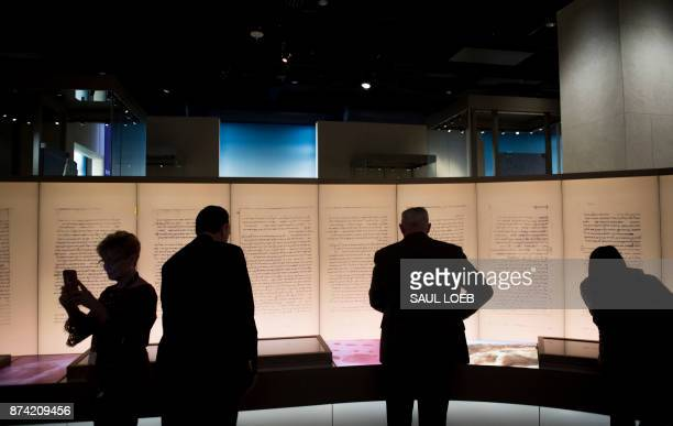 Visitors look at an exhibit about the Dead Sea scrolls during a media preview of the new Museum of the Bible a 430000 squarefoot museum dedicated to...