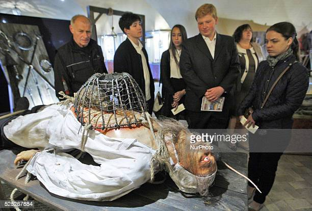 Visitors look at an exhibit during the 'Medieval Executions and Punishments' exhibition in Kiev Ukraine 07 October 2015 More two hundred exhibits and...