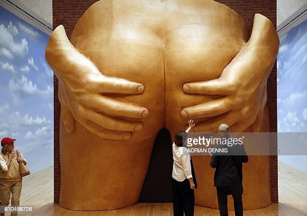 Visitors look at an installation entitled 'Project for a Door' by artist Anthea Hamilton during a photocall for the 2016 Turner Prize at Tate Britain...