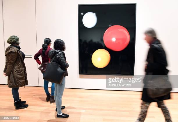 Visitors look at artwork by Iranianborn photographer Shirana Shahbazi at The Museum of Modern Art on February 3 2017 in New York City The famed New...