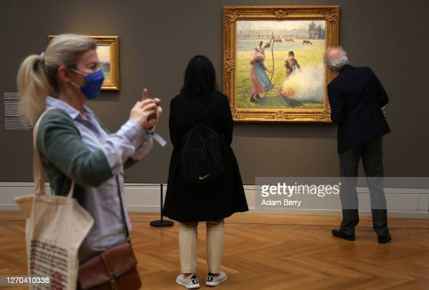"""Visitors look at artworks during the press preview for the exhibition """"Impressionismus. Die Sammlung Hasso Plattner"""" at Museum Barberini on September..."""
