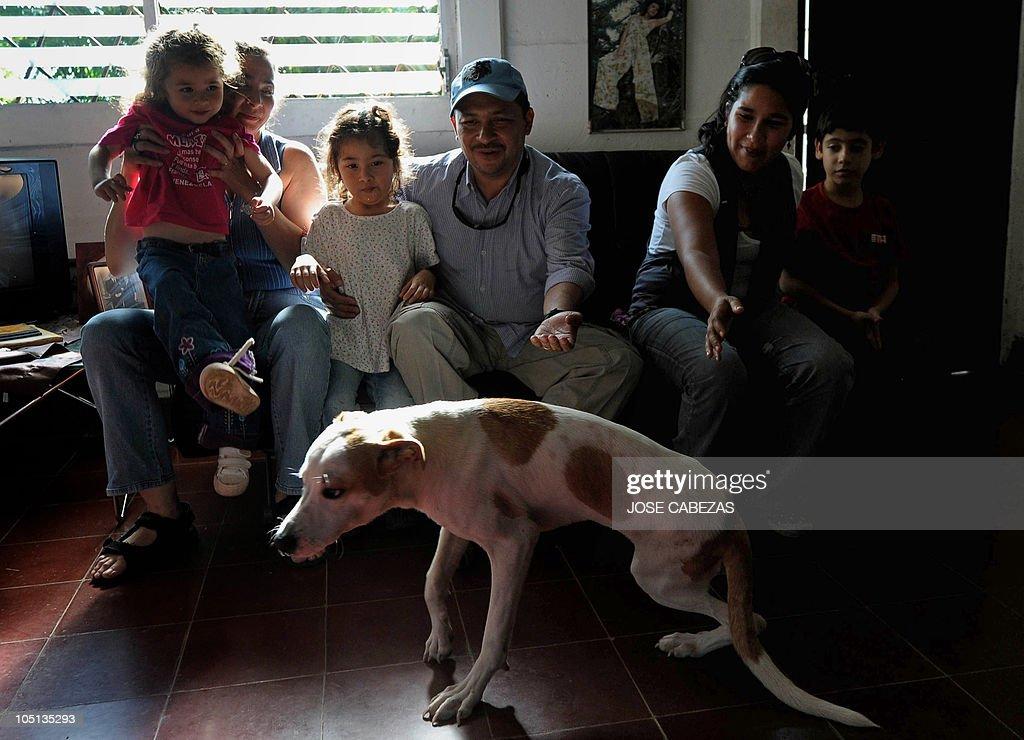 Visitors Look At Beto A Mistreated Dog At The Urban Dog