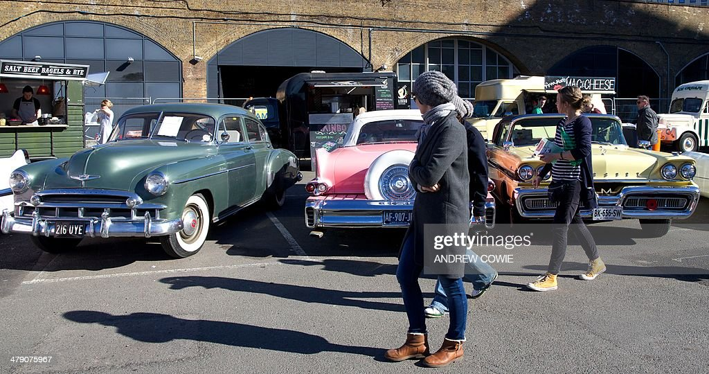 Visitors look at classic cars displayed at the Classic Car boot ...