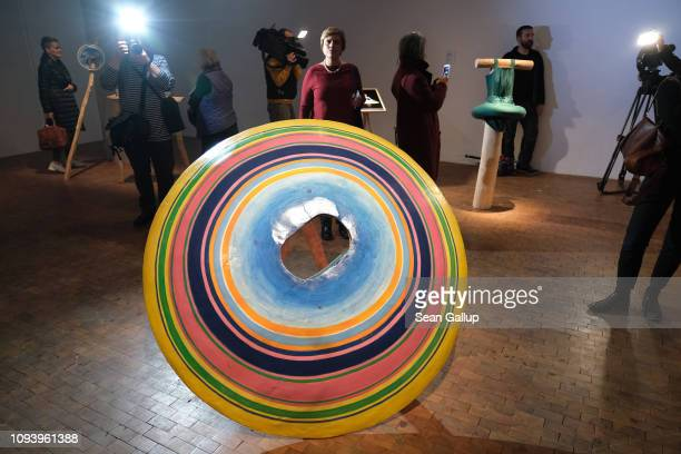 Visitors look at dancers' costumes made of wood from the 1920s dance group Triadisches Ballett at 'Bauhaus 100 Years The Opening Festival' '100 Jahre...