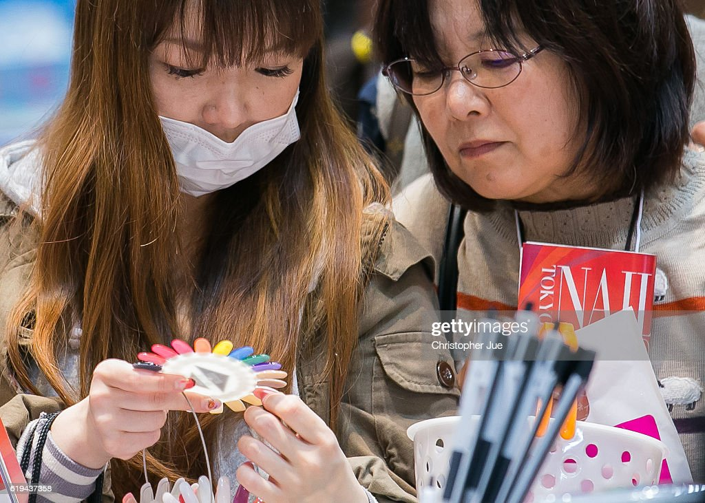 Visitors look at different color nail samples during the Tokyo Nail Expo on October 31, 2016 in Tokyo, Japan. According to the organiser, approximately 50,000 people visited this 'largest nail expo in the world' held on October 30th and 31st.