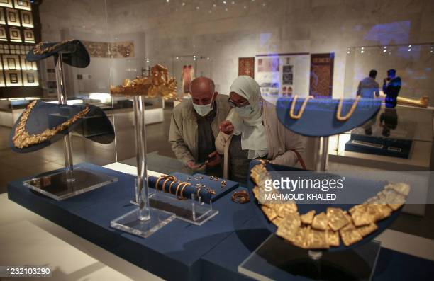 Visitors look at displayed ancient jewellery at Egypt's new National Museum of Egyptian Civilisation , in the Fustat district of Old Cairo, during...