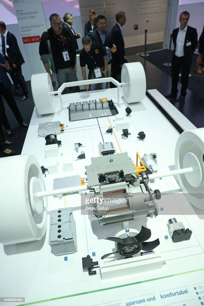 Visitors look at electric car components at the Robert Bosch stand at the 2017 Frankfurt Auto Show on September 12, 2017 in Frankfurt am Main, Germany. The Frankfurt Auto Show is taking place during a turbulent period for the auto industry. Leading companies have been rocked by the self-inflicted diesel emissions scandal. At the same time the industry is on the verge of a new era as automakers commit themselves more and more to a future that will one day be dominated by electric cars.