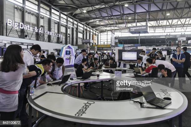 Visitors look at exhibits at the Huawei Connect 2017 conference in Shanghai China on Tuesday Sept 5 2017 Huawei Technologies Co aims to establish a...