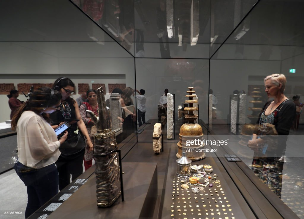 Visitors look at exhibits during the opening of the Louvre Abu Dhabi