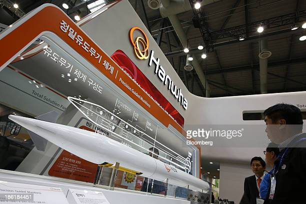 Visitors look at Hanwha Corp. Precision guided munitions at the Seoul International Aerospace & Defense Exhibition 2013 in Goyang, South Korea, on...