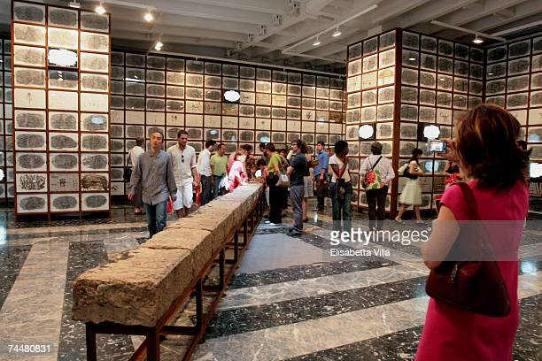 Visitors look at Japanese artist Masao Okabe's installation Is There a Future for Our Past The Dark Face of the Light during the Venice Biennale 52nd...
