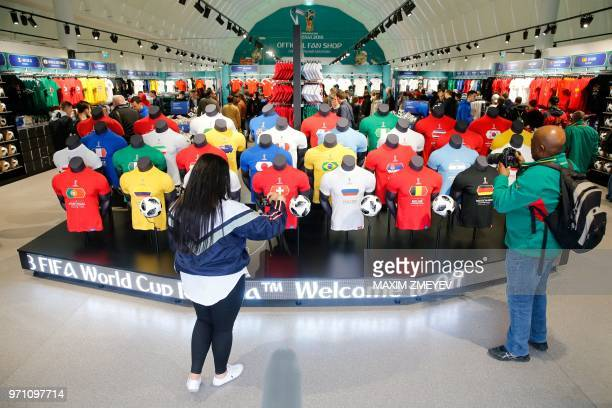 Visitors look at jerseys at the official shop of the FIFA Fan Fest in Moscow on June 10 ahead of the Russia 2018 World Cup