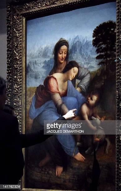 Visitors look at 'La Vierge et l'enfant avec Sainte Anne' by Italian painter Leonardo da Vinci on March 23 2012 in the Louvre Museum during the...