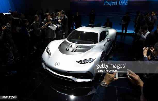 Visitors look at MercedesBenz AG's MercedesAMG Project ONE coupe during the Tokyo Motor Show at Tokyo Big Sight on October 25 2017 in Tokyo Japan The...