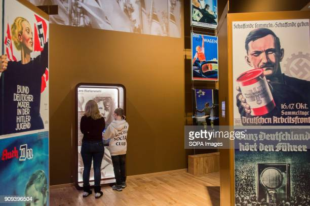 Visitors look at Nazi and Soviet propaganda in one of the exhibit rooms at the World War 2 Museum The world war 2 museum in the Polish city of Gdansk...