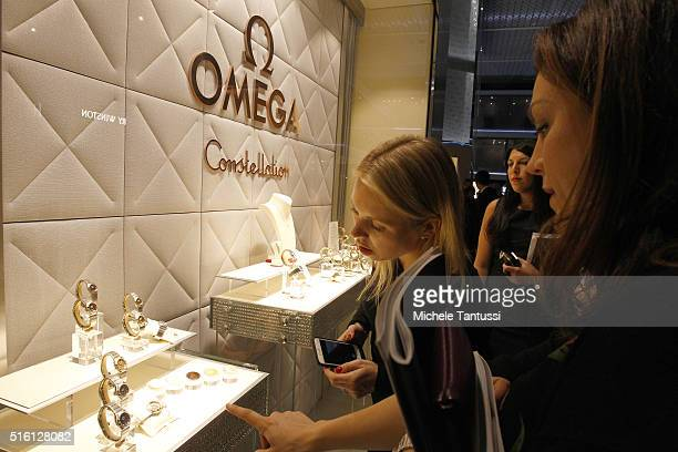 Visitors look at Omega watches at the Baselworld watch and jewellry Fair trade on March 17 2016 in Basel Switzerland The watch and jewelry show Held...