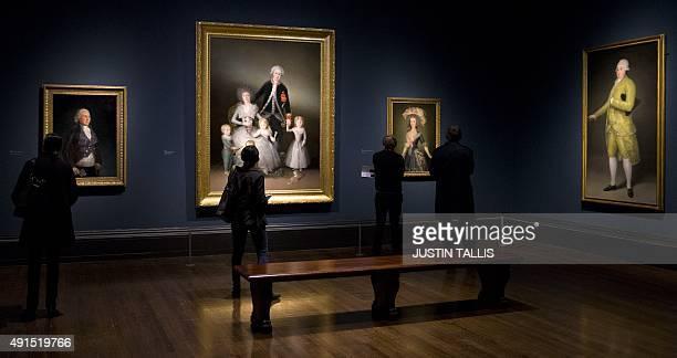 Visitors look at paintings 'The Duke of Osuna around 1795' 'The Duke and Duchess of Osuna and their Children 1788' 'The CountessDuchess of Benavente...
