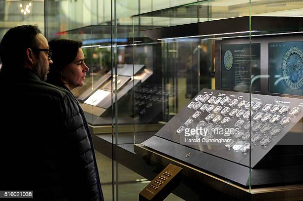 Visitors look at Patek Philippe watch movement during Baselworld on March 16 2016 in Basel Switzerland Held annually Baselworld is the most important...