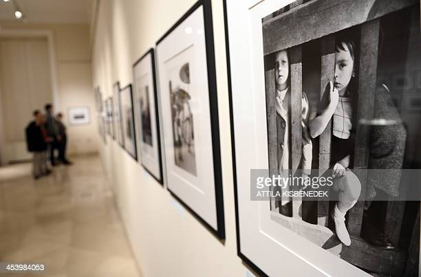 STORY Visitors look at pictures at a photo exhibition of Hungarianborn US photographer Robert Capa in the Hungarian National Museum in Budapest on...