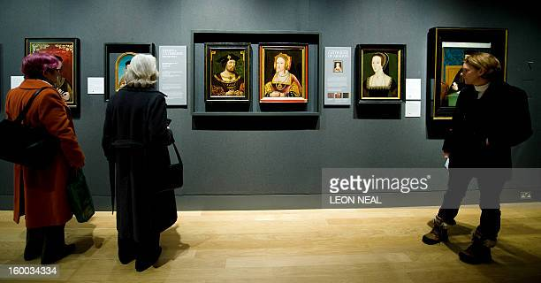 Visitors look at portraits of Britain's King Henry VIII and Catherine of Aragon displayed together for the first time in nearly 500 years at the...