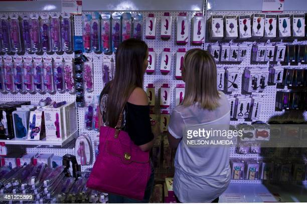 Visitors look at products in a stand during the Erotika Fair in Sao Paulo Brazil on March 28 2014 The event the biggest of its kind in Latin America...