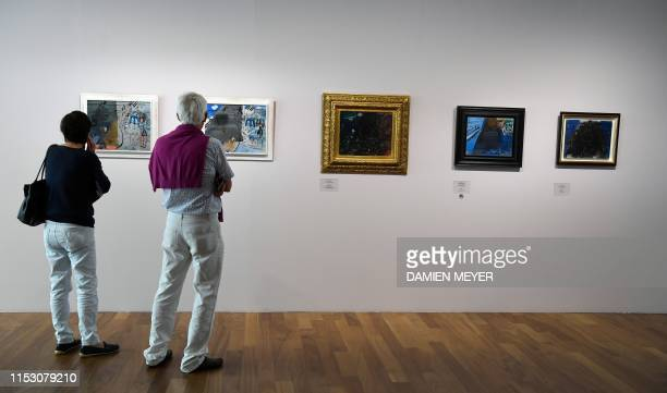 Visitors look at Raoul Dufy paintings at the MuMa Andre Malraux Museum of Modern Art in Le Havre on June 28 during an exhibition dedicated to Le...
