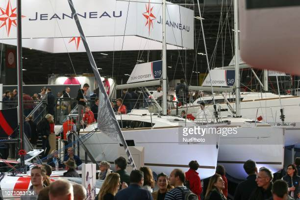 Visitors look at sailing boats of the French yacht manufacturer Jeanneau during the Paris International Boat Show on December 9 2018 at the Porte de...