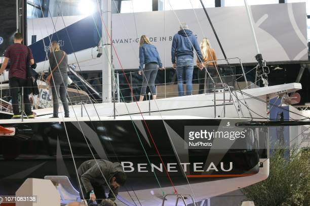 Visitors look at sailing boats of the French yacht manufacturer Beneteau during the Paris International Boat Show on December 9 2018 at the Porte de...