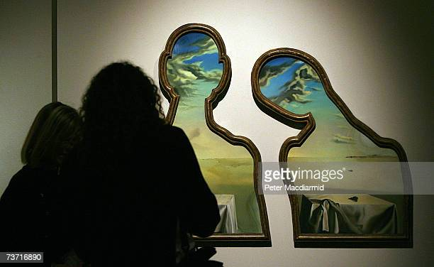Visitors look at Salvador Dali's A couple with their heads full of clouds at the Surreal Things Exhibition at the VA Museum on March 27 2007 in...