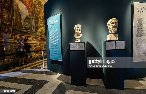 Visitors look at sculptures during the 'Archimedes art and science of the inventor' exhibition dedicated to Greek scientist Archimedes on May 30 at...
