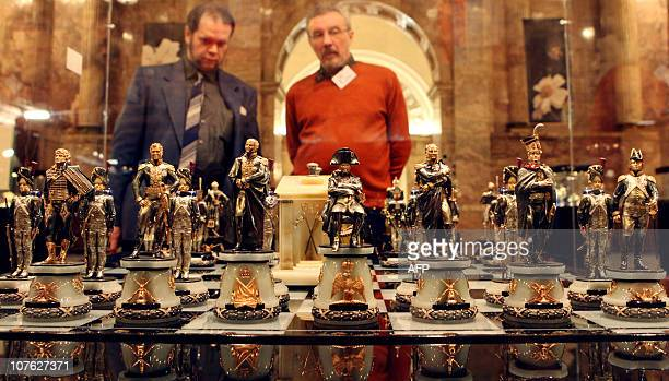 """Visitors look at the """"1812"""" chess set, which depics Russian and French participants of Napoleon's Russian campaign displayed at an exhibition in the..."""