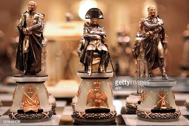 """Visitors look at the """"1812"""" chess set, which depicts Napoleon Bonaparte and his ''marechaux'' displayed at an exhibition in the Ethnographic museum..."""