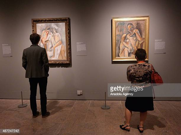 Visitors look at the art works during the press preview for 'Cubism The Leonard A Lauder Collection' exhibition which opens on October 20 2014...