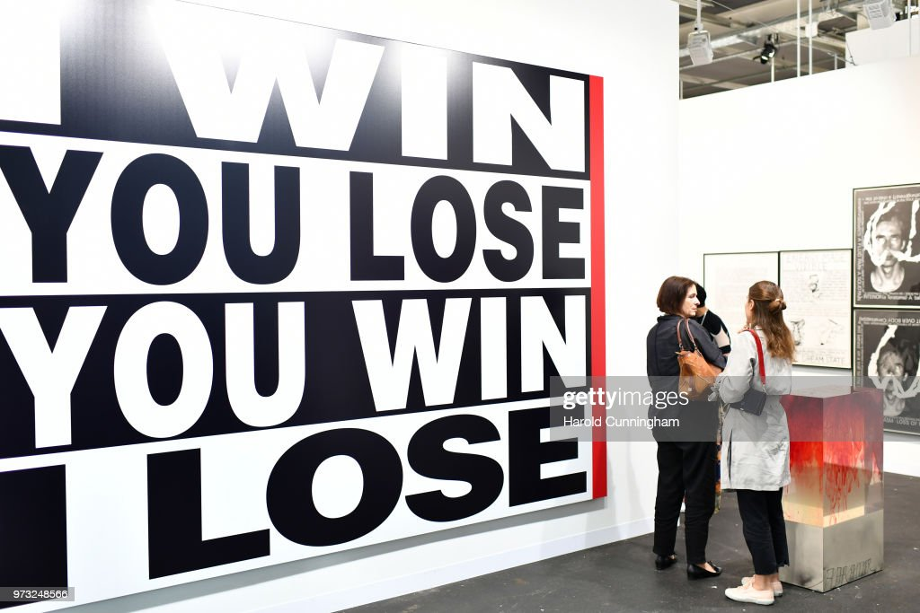 Visitors look at the artwork of Barbara Kruger 'Untitled' during the press preview for Art Basel at Basel Messe on June 13, 2018 in Basel, Switzerland. Art Basel is one of the most prestigious art fair in the world showcasing the work of more than 4,000 artists selected by 300 leading art galleries.