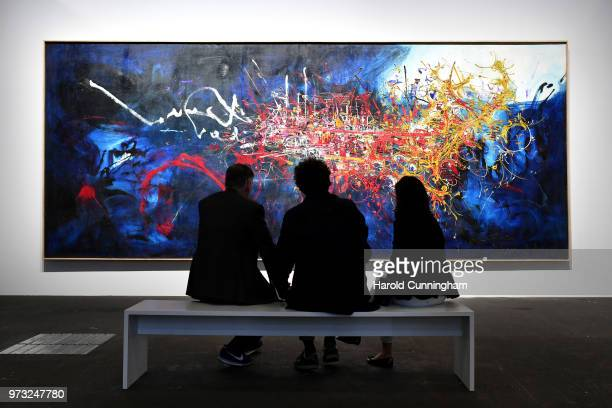 Visitors look at the artwork of Georges Mathieu 'Hommage au Connetable Bourbon' during the press preview for Art Basel at Basel Messe on June 13 2018...
