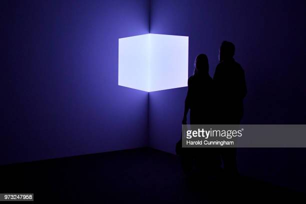 Visitors look at the artwork of James Turell 'Catso Violet' during the press preview for Art Basel at Basel Messe on June 13 2018 in Basel...