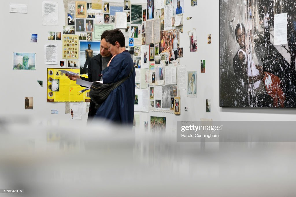Visitors look at the artwork of Mikhael Subotzky and Patrick Waterhouse 'Ponte City' during the press preview for Art Basel at Basel Messe on June 13, 2018 in Basel, Switzerland. Art Basel is one of the most prestigious art fair in the world showcasing the work of more than 4,000 artists selected by 300 leading art galleries.