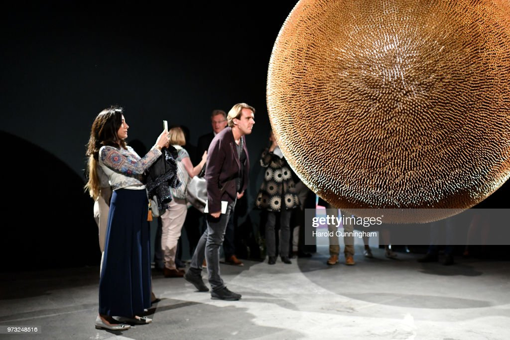 Visitors look at the artwork of Robert Longo 'Death Star II' during the press preview for Art Basel at Basel Messe on June 13, 2018 in Basel, Switzerland. Art Basel is one of the most prestigious art fair in the world showcasing the work of more than 4,000 artists selected by 300 leading art galleries.
