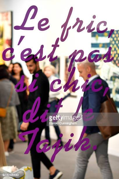 Visitors look at the artwork of Slavs and Tatars 'Nations 5' during the press preview for Art Basel at Basel Messe on June 13 2018 in Basel...