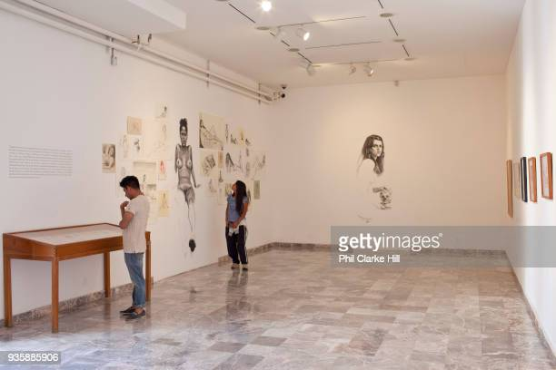 Visitors look at the artworks on show at the Museo de los Pintores Oaxaqueños / Museum of Oaxacan painters Oaxaca is known throughout Mexico and...