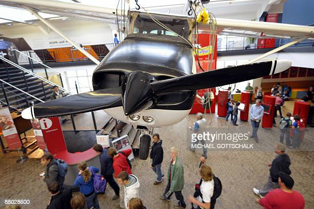 Visitors look at the 'Cessna 172' that was used by young German Matthias Rust to land on the Red Square in Moscow on May 28 1987 presented at the...