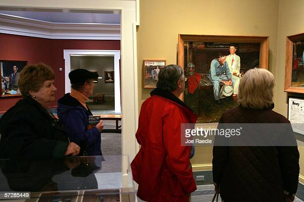 Visitors look at the copy of Norman Rockwell's painting titled Breaking Home Ties which has been hanging on display in the Norman Rockwell Museum on...