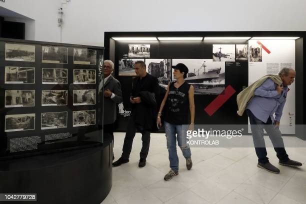 Visitors look at the exhibition Hercules alla guerra at the Naples National Archaeological Museum In the exhibition you can see photographs and...